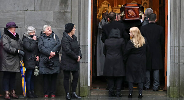 Eileen O'Riordan (front right) mother of Cranberries singer Dolores O'Riordan, turns as her daughter's coffin arrives at St Joseph's Church in Limerick. Pic: Niall Carson/PA Wire
