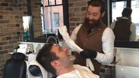 Munster rugby player launches Mercy Hospital Foundation's Decembeard campaign with a trim