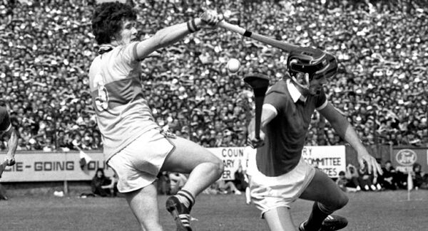 Cork's Ray Cummins (right) flicking the ball past Clare fullback Jim Power. Cummins goal in the 1977 Munster final turned the match around.