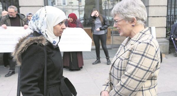 Ibrahim's sister Somaia Halawa with Children's Minister Catherine Zappone at a vigil for her brother outside Leinster House earlier this year.
