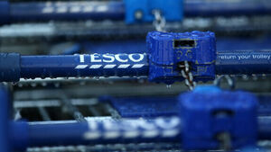 Tesco shares fall despite dividends being restored