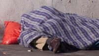 Homeless man sleeping soundly outside housing summit was not an extra