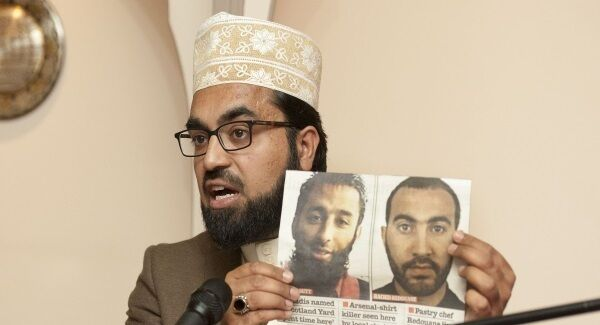 Imam Shaykh Dr Umar Al-Qadri holding a picture of two of the London attackers at a press conference held at the Al Mustafa Islamic Cultural Centre in Blanchardstown, Dublin.
