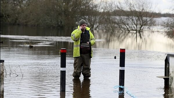 Kevin 'Boxer' Moran stands in flood water in Athlone. Picture: PA