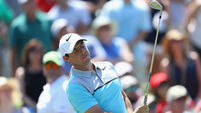 Off-key Rory McIlroy hangs in as Shane Lowry's woes continue