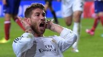 Real Madrid fend off Napoli storm to ease through