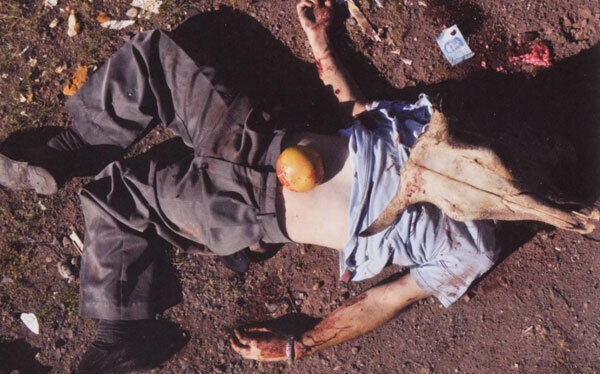 Terror: A victim is left decapitated by Mexican drug cartels as a warning to informers, police, and rival gangs. Picture: From El Narco: The Bloody Rise of the Mexican Drug Cartels.