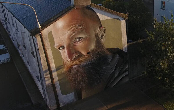 Smug One's portrait of artist Dermot McConaghy in Waterford has pigeons nesting in the beard.
