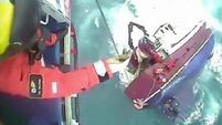 WATCH: Fishermen rescued from Irish vessel moments before it sinks