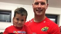 Cork boy celebrates beating cancer with Munster team before first day of school