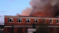 Firefighters battle blaze at disused factory with asbestos roof