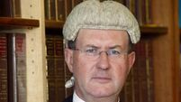 Tributes paid to Justice Brian McGovern on his final day on the bench