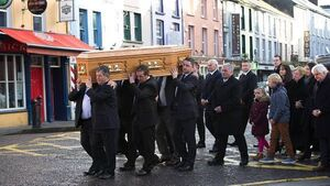 Political elite gather as community mourns former Minister Joe Walsh