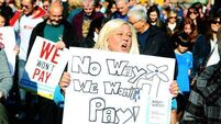 Thousands march against water charges