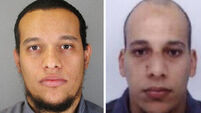 Shooting brothers 'dead' as police storm both Paris hostage sites