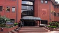 Charity boss 'pinned boy to bed and raped him', court hears