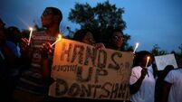 Tensions rise in Ferguson ahead of ruling on shooting