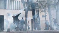 French riot police clash with youths on fringes of environmental rallies
