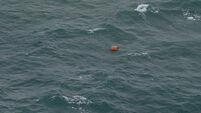Body wearing life jacket recovered in AirAsia plane search