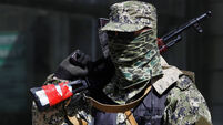 Heavy combat at Ukrainian airport ahead of ceasefire talks