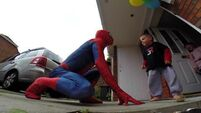 Dad dresses up as Spiderman and jumps off roof  for terminally ill son's birthday