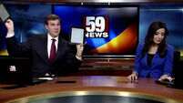 News anchor not impressed by co-presenter's dance moves