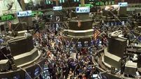 US stock market edges to new record