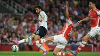 Oxlade-Chamberlain saves point for Gunners in London derby