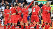 Premier League review: Lallana and Henderson secure Reds win; Cisse saves Newcastle