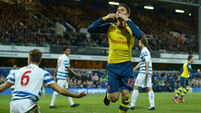 Arsenal hold on for win at QPR