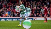 Celtic cement top position with victory at Aberdeen