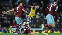 Gunners battle to 2-1 win over Hammers