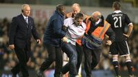 Three charged over 'PR stunt' pitch invasion
