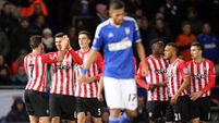 Long helps Southampton advance past Ipswich