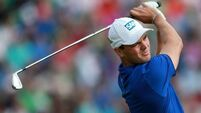 Kaymer builds strong lead as McIlroy wilts in heat