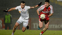 Four late Tyrone points ensure share of the spoils with Derry