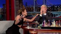 Jennifer Lopez sprays her perfume into David Lettermans eyes
