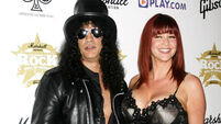 Slash files fo divorce from wife of 13 years