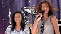 Bobbi Kristina Brown's family have been singing Whitney Houston songs at her bedside