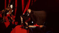 Video: Madonna yanked to the floor in cloak mishap