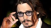 Johnny Depp has injured his hand while filming Pirates of the Caribbean
