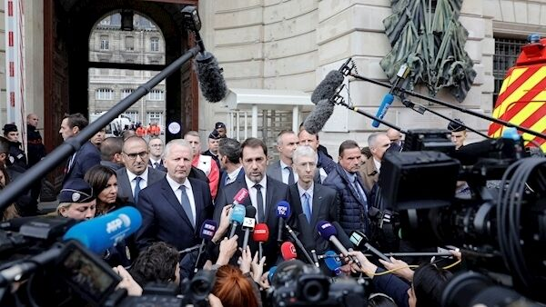 French Interior Minister Christophe Castaner, center, and Paris police prefect Didier Lallement, right next to Castaner, give a press conference outside the Paris police headquarters. AP Photo/Kamil Zihnioglu).