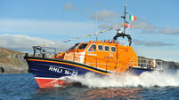 Rescuers brave gale-force conditions after fishing vessel runs aground off Cork coast
