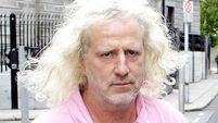 Mick Wallace 'not deterred' by Peter Robinson's threat of legal action