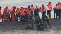 Hopes fade in Chinese boat rescue