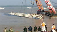 Chinese cruise ship capsize blamed on storm
