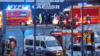 French police arrest two in connection with Paris supermarket attack in January