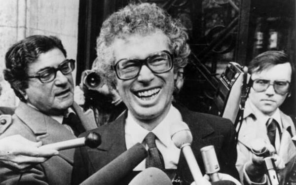 In this Jan. 31, 1980 photo, Ken Taylor laughs as he answers questions during a meeting with journalists outside the Canadian Embassy in Paris.