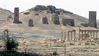 IS militants accused of destroying ancient Palmyra arch
