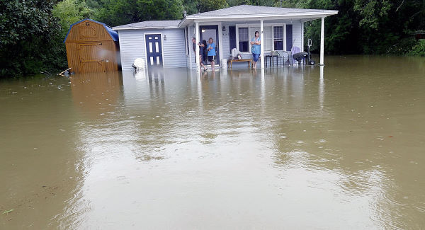 People watch as the flood inches toward their door outside of Conway, South Carolina yesterday. Pic: Janet Blackmon Morgan/The Sun News